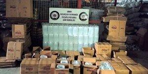 Adana'da 'antifrizli cam suyu' yazılı kolilerde bin litre etil alkol ele geçirildi!