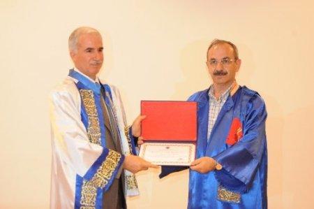 KÜ'ye atanan personel için cübbe töreni düzenlendi